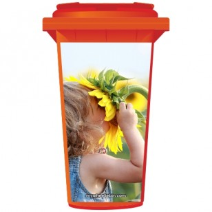 Young Girl Sniffing A Sunflower Wheelie Bin Sticker Panel